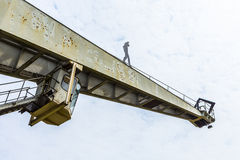 Old crane with iron man in Bingen, Royalty Free Stock Photo