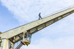 Old crane with iron man in Bingen, Stock Photography