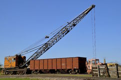 Old crane loading a a car on the railroad Stock Photo