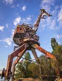 Crane in Chernobyl Zone. Old crane over Yanov Backwater in Chernobyl Exclusion Zone, Ukraine Royalty Free Stock Images