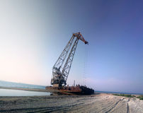 Old crane in port Stock Images