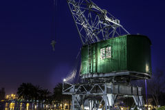Old crane at the port by night Royalty Free Stock Images