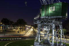 Old crane at the port by night Stock Images