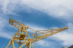 Old crane. And sky with clouds Royalty Free Stock Photography