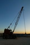 Old crane at sunset Royalty Free Stock Image