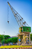 Old crane transformed in a monument in port of Tarragona, Spain Royalty Free Stock Photo