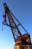 Old crane in Venice harbor, Italy Stock Photography