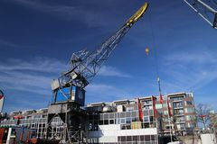 Old cranes, shiips, towers, trains and other parts of the harbor for public exhibitation in the Leuvehaven in Rotterdam Stock Photography