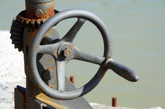 Old crank. Old rusty crank in harbour Royalty Free Stock Photo