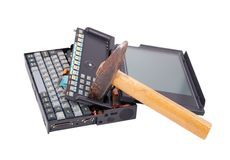 Old crashed notebook and hammer Stock Photo
