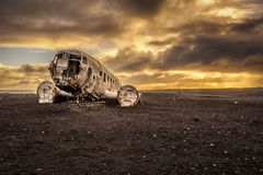 Old crashed plane in Iceland with heavy storm clouds Royalty Free Stock Photography
