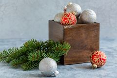 Christmas balls in an old wooden box. stock images
