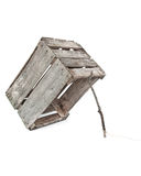 Old crate trap. Old wood rustic weathered crate propped up with a stick trap Stock Image