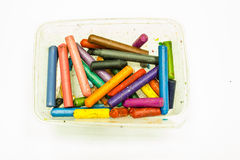 The Old crayons in Plastic Box. On white background Stock Photography