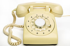 Old cream telephone Stock Photography