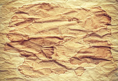 Old creased stained paper background or texture. Royalty Free Stock Images