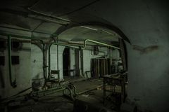 Old Creepy Basement Of Abandoned Asylum. Old Rotten Boiler, Heating Pipes Stock Photos