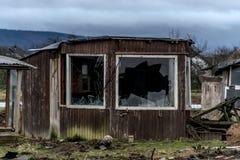Old creepy dark abandoned destructive dirty house broken windows. Old creepy dark abandoned destructive dirty house with broken windows Royalty Free Stock Photo