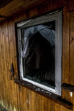 Old creepy dark abandoned destructive dirty house broken windows Stock Photography