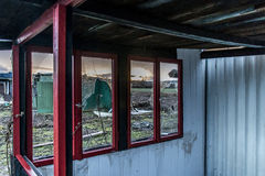 Old creepy dark abandoned destructive dirty house broken windows. Old creepy dark abandoned destructive dirty house with broken windows Stock Photo