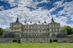 Old creepy dark castle under the blue sky. In Ukraine stock images