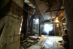 Old creepy, dark, decaying, destructive, dirty factory Stock Images