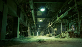 Old creepy, dark, decaying, destructive, dirty factory. Equipment, cables and piping as found inside of a industrial power plant Stock Photography