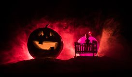 Old creepy eerie wooden baby crib in dark toned foggy background. Horror concept. Scary baby and bed silhouette in dark. Halloween stock photo