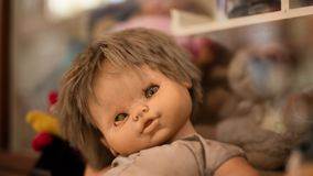 Creepy one-eyed baby doll royalty free stock photo