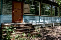 Old creepy scary abandoned building at the forgotten summer camp Royalty Free Stock Image