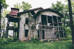 Old creepy wooden abandoned haunted mansion royalty free stock photo