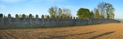 Old crenellated wall pano Stock Photos