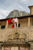 Old Crest and Montenegro Flag in Kotor Stock Photos