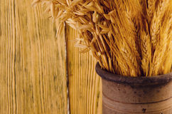 Old crock with wheat ears Royalty Free Stock Photos