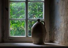 The old crock on windowsill  in farmhouse Stock Photos