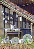 Old crockery at a wooden  shelter Stock Image