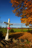 Old cross. And tree in autumn Stock Photography