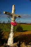 Old cross. Old white cross in fields Royalty Free Stock Image