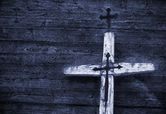 Old cross. Old wooden cross against wooden background. Blue tone Stock Photography