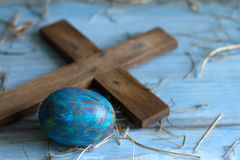 Old cross and abstract grunge easter egg concept Royalty Free Stock Photo