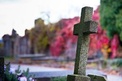 Old Cross in the Autumn Cemetery Stock Images