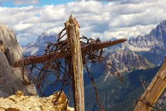 Old cross with a barbed wire, reminiscence of a World War I, Ita Stock Photo