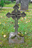 Old cross in a cemetery. Royalty Free Stock Photo