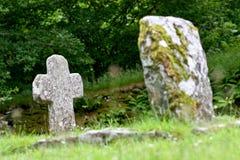 Old cross, Glendalough cemetery, Ireland Stock Photos