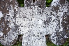 Old cross gravestone. With engraved Old Church Slavonic inscriptions. Kyiv, Ukraine. Close up Stock Image