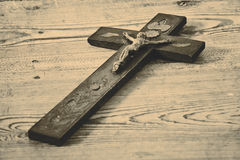 Old cross with jesus on the old floor Stock Image