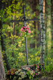 Old Cross. Old metal cross in the woods Royalty Free Stock Photography