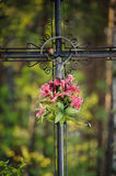 Old Cross. Old metal cross in the woods Stock Photography