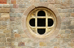 Old cross in stone window Stock Photography