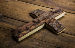 Old cross on wooden background for mourning or death concepts. Royalty Free Stock Photos